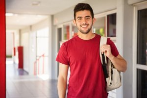Portrait,Of,A,Hispanic,College,Student,Carrying,A,Backpack,And